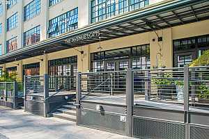 MLS # 18213811 : 1400 NW IRVING ST  UNIT 320