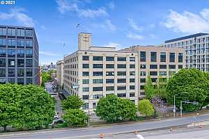 MLS # 21402365 : 1400 NW IRVING ST 306